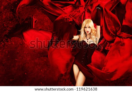 Sexy Blonde Fantasy Woman with Splashing Red Silk - stock photo