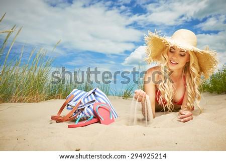 Sexy blonde girl on the summer beach - stock photo