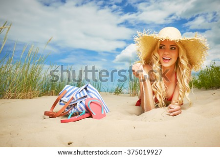 Sexy blonde girl on the summer beach