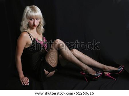sexy blonde in a black peignoir - stock photo