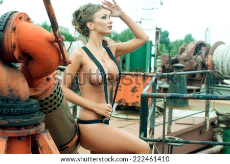 Sexy blonde in harness on ghost ship - stock photo