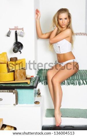 sexy blonde in white underwear sitting on the furnace, in the interior, glamour photography, studio lighting