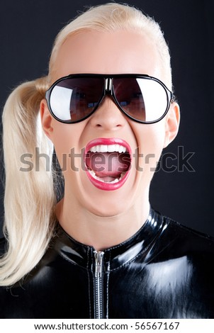 Sexy blonde is wearing sunglasses and screaming