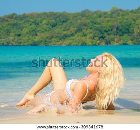 Sexy Blonde On a Beach  - stock photo