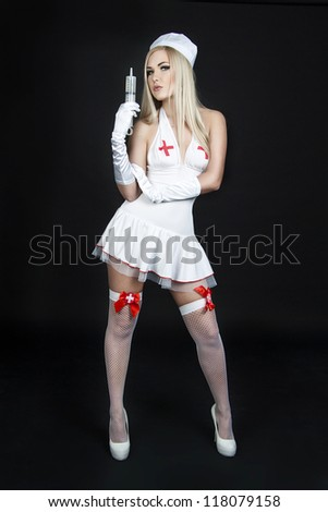 Sexy Blonde wearing a sexy white costume - stock photo