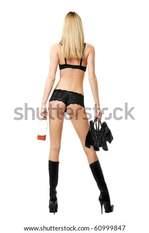 Sexy blonde with handbag and bottle in her hands. Rear view - stock photo
