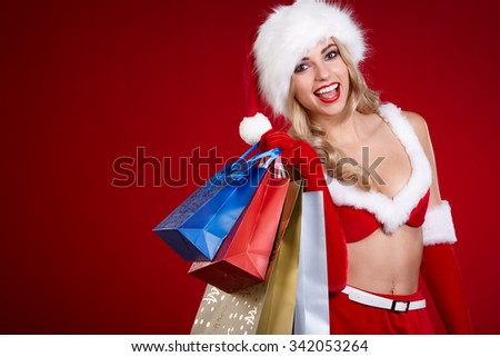 sexy blonde woman holding colorful shopping bags - stock photo