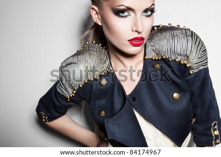 sexy blonde woman in dark blue jacket and big red lips - stock photo