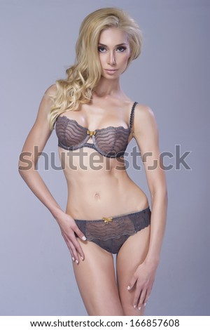 Sexy blonde woman in  lingerie  - stock photo