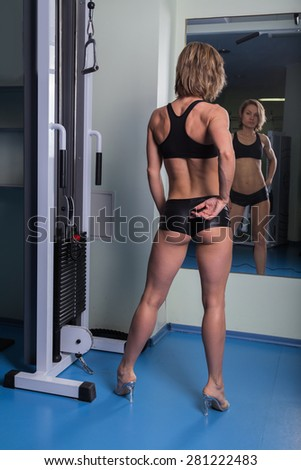 Sexy, blonde woman in the gym. Sports, health, a beautiful body.