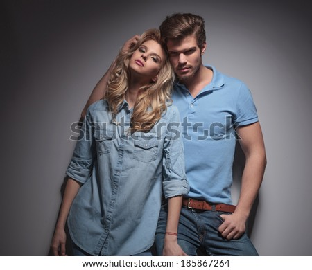 sexy blonde woman leaning against her boyfriend looking happy - stock photo