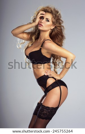 Sexy blonde woman posing in lingerie. Studio shot. - stock photo