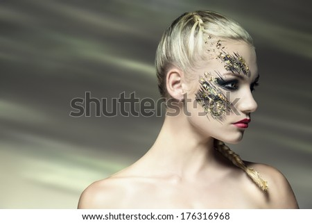 sexy blonde woman posing with cute strong make-up and bride hair-style. Creative beauty shoot