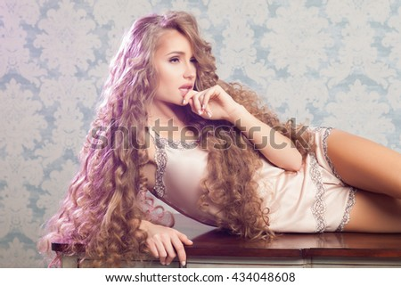 Sexy blonde woman with fashion make-up and curly hair. Skin and hair care concept - stock photo