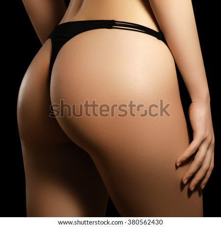 Sexy body of a beautiful woman. Beautiful woman body. Perfect shining skin for summer. Slim tanned woman's body. Isolated over white background. Beautiful sexy female slim tanned body - stock photo
