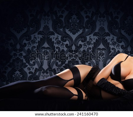 Sexy body of young and beautiful woman in lingerie over vintage background - stock photo