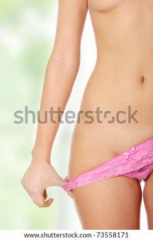 Sexy body of young beautiful caucasian woman. She is taking off her sexy lingerie. - stock photo