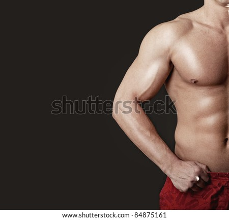 Sexy bodybuilder showing his muscular body - stock photo