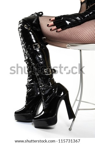 Sexy Boots and Legs on Leather Chair
