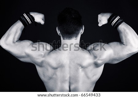 Sexy boy's back on black - stock photo