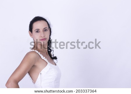Sexy Brunette Bride in her wedding gown - stock photo