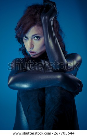 sexy brunette in black latex bodysuit tight and wild poses - stock photo