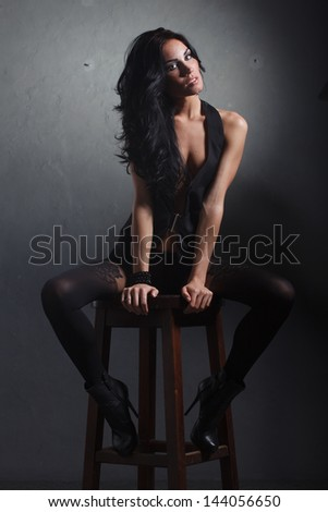 sexy brunette in pantyhose stunned - stock photo