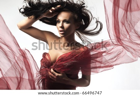 Sexy brunette in the windy day - stock photo