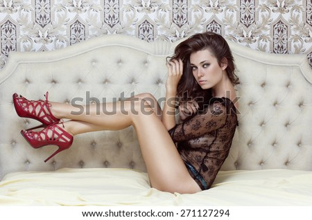 Sexy brunette lying on the bed in underwear. - stock photo