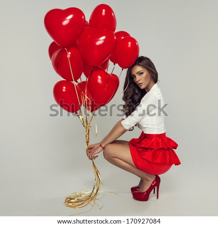 Sexy brunette with balloons heart - stock photo