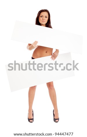 Sexy brunette with placard. Isolated over white. - stock photo