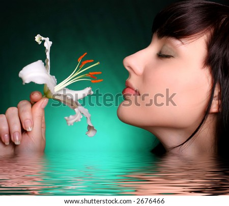 sexy brunette with white lily flowers in water - stock photo