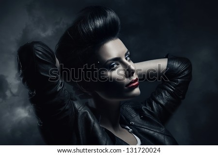 sexy brunette woman in jacket - stock photo