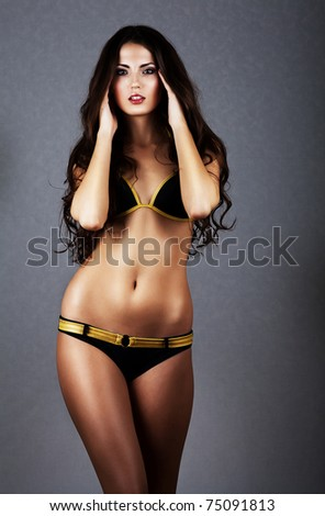 sexy brunette woman in swimwear - stock photo