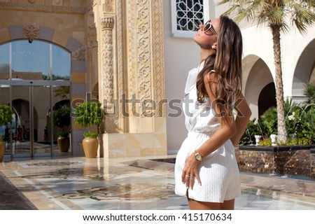 Sexy brunette woman in vacation time. Beauty stylish brunete woman posing in white summer clothes. - stock photo