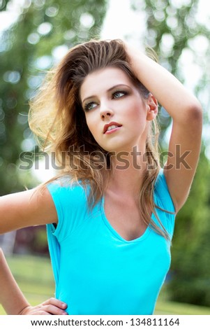 Sexy brunette woman posing at outdoor - stock photo