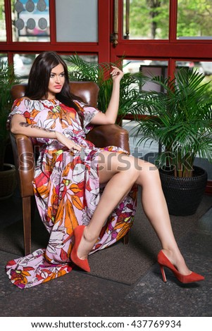 Sexy brunette woman posing in chair - stock photo