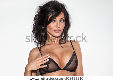 Sexy brunette woman posing in lingerie. Girl with long curly hair - stock photo