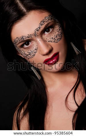 sexy brunette woman with chubby red lips and mask on face