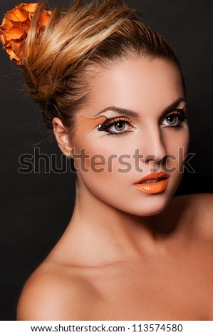 sexy brunette woman with face art - stock photo