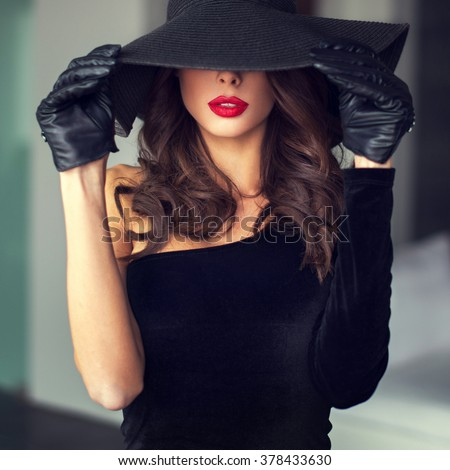 Sexy brunette woman with red lips in hat indoor, sensuality - stock photo