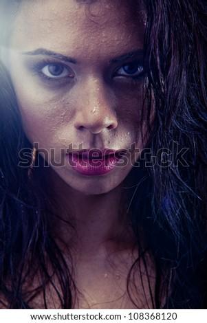sexy bruntette wet woman portrait - stock photo