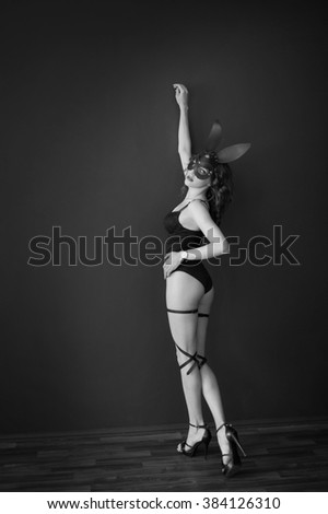 Sexy Bunny. Erotic bunny. Pretty sexy woman in lingerie in leather bunny mask. Fetish. Black and white photo of a sexy woman