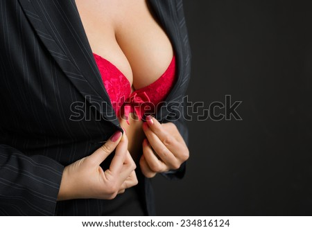 Sexy business lady wearing red bra - stock photo