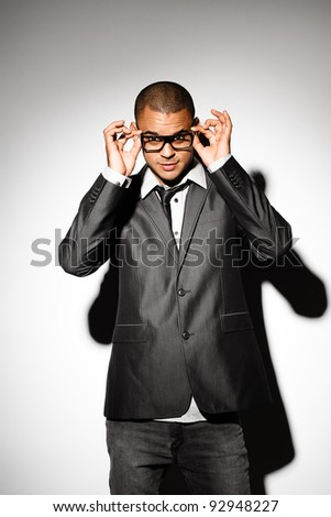 Sexy Business man posing with glasses - stock photo