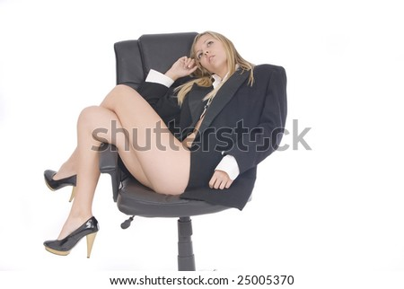 sexy bussiness woman sitting in an armchair - stock photo