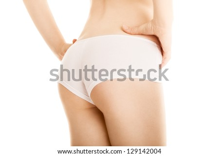sexy buttocks of slim woman on white background - stock photo