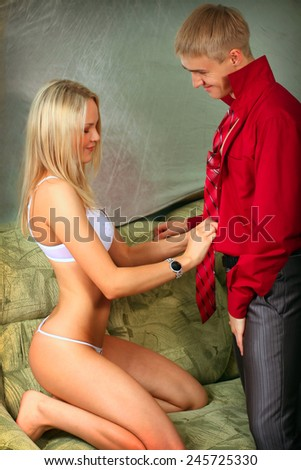 Sexy caucasian couple in love sexual games - stock photo