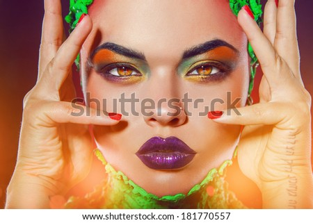 Sexy caucasian woman with cat eyes and creative makeup in studio