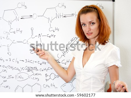 Sexy chemistry teacher in classroom